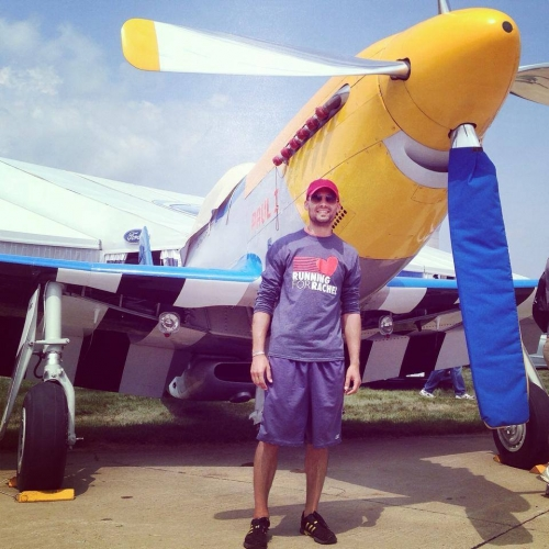 Marc is 'Running for Rachel' in front of a P-51 Mustang at EAA Air Venture Oshkosh (an annual gathering of aviation en